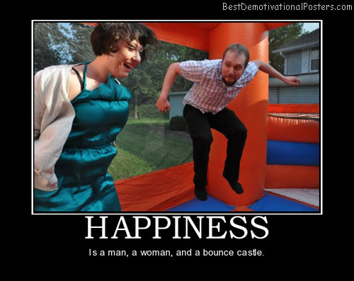 Happines is a man, woman, and bounce castle